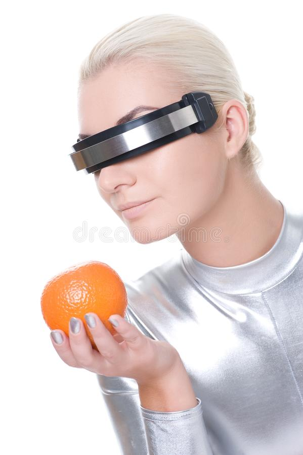 Cyber Woman With An Orange Stock Photo