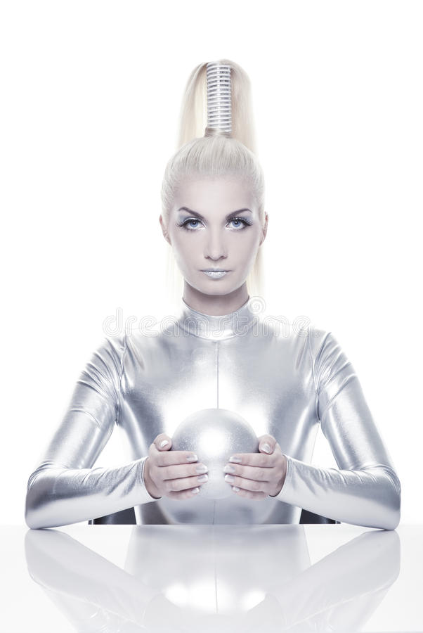 Cyber woman with silver ball royalty free stock photos