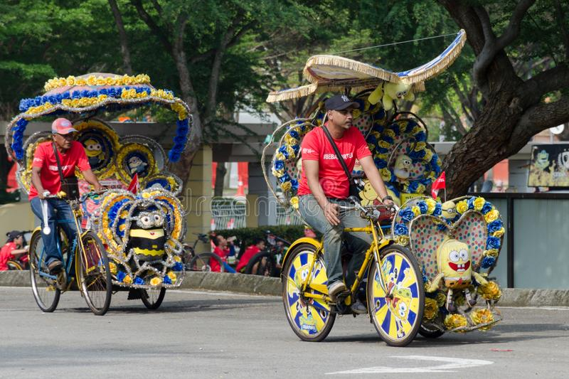 Tourist entertainment - trishaw on his customized tricycle transport, brightly decorated with children`s cartoon and flowers. royalty free stock images