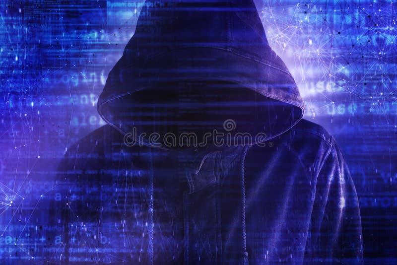 Cybersecurity, hacker de computador com hoodie fotografia de stock
