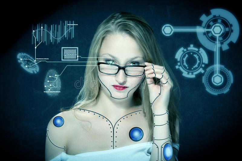 Cyborg Checkup. Photo of female cyborg checking up herself with iris scan royalty free stock image