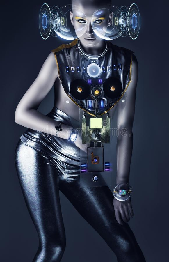 Cyborg woman with hologram display and techno suit. In dark stock photos