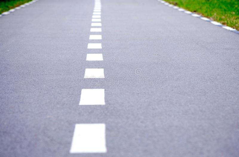 Cycle path in perspective, road for sports, running track.  royalty free stock photos