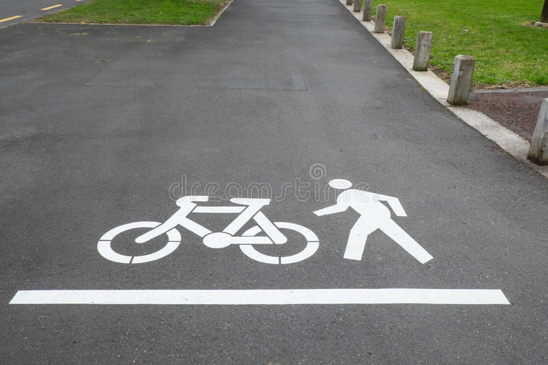 Cycle and pedestrian footpath or sidewalk in Auckland, New Zealand, NZ. Cycle and pedestrian road markings on footpath or sidewalk in Auckland, New Zealand, NZ stock photography