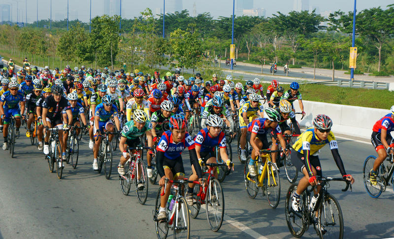 Cycle race, Asia sport activity, Vietnamese rider. HO CHI MINH CITY, VIET NAM- JAN2: Amazing cycle race, sport activity to happy new year at Asia, rider wear royalty free stock images