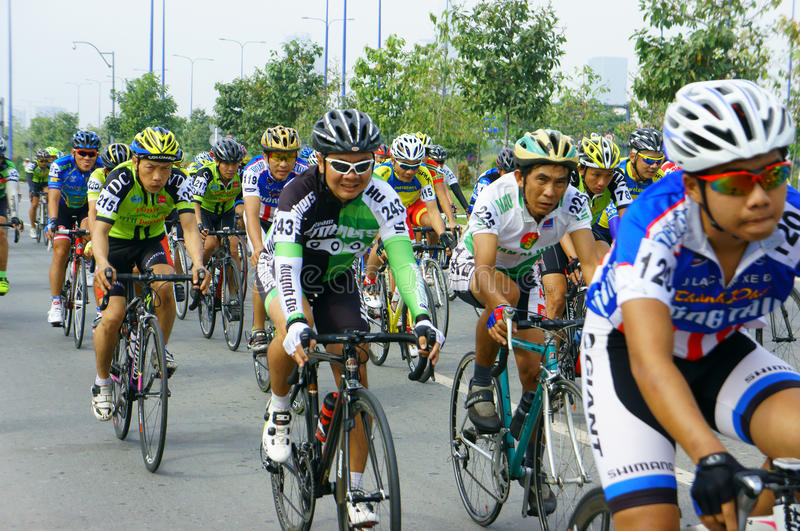 Cycle race, Asia sport activity, Vietnamese rider. HO CHI MINH CITY, VIET NAM- JAN2: Amazing cycle race, sport activity to happy new year at Asia, rider wear royalty free stock image