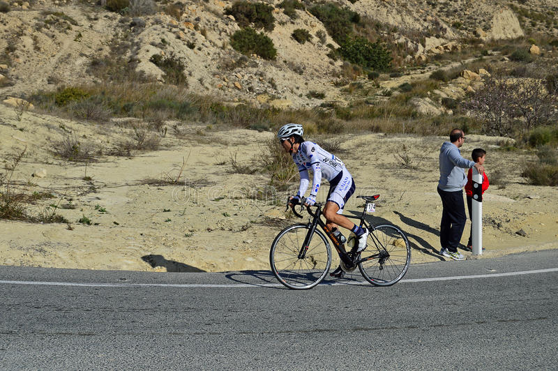 Cycle Race. A lone racer in the mountains during stage 4 of the 2016 Vuelta de Valencia cycle race stock photography