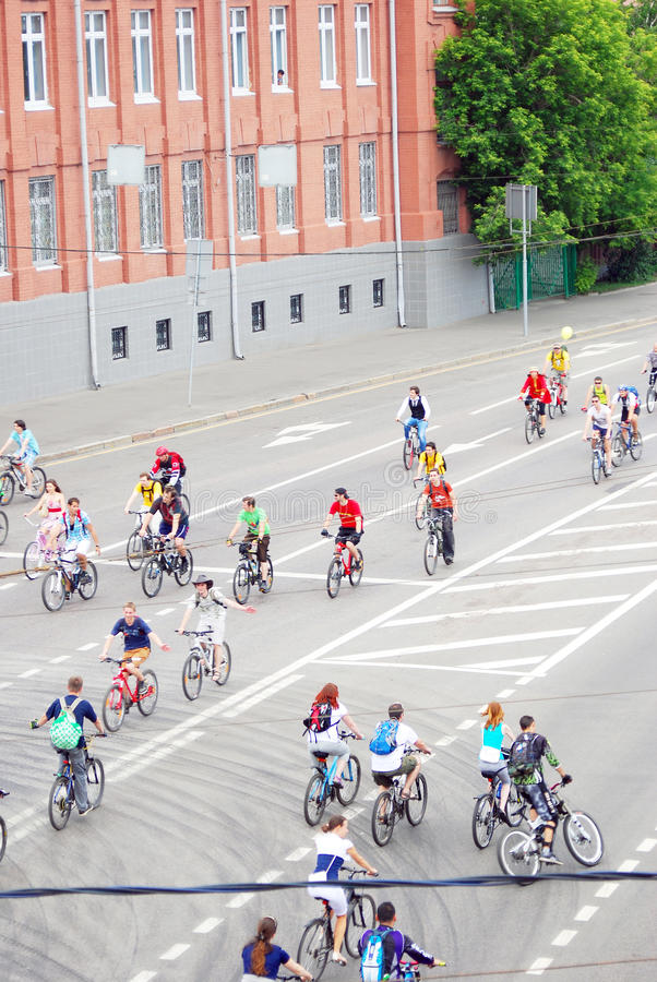 Cycle race in Moscow. Many people ride bikes. Cycle race in Moscow city center on June 16, 2013 in Moscow royalty free stock photos