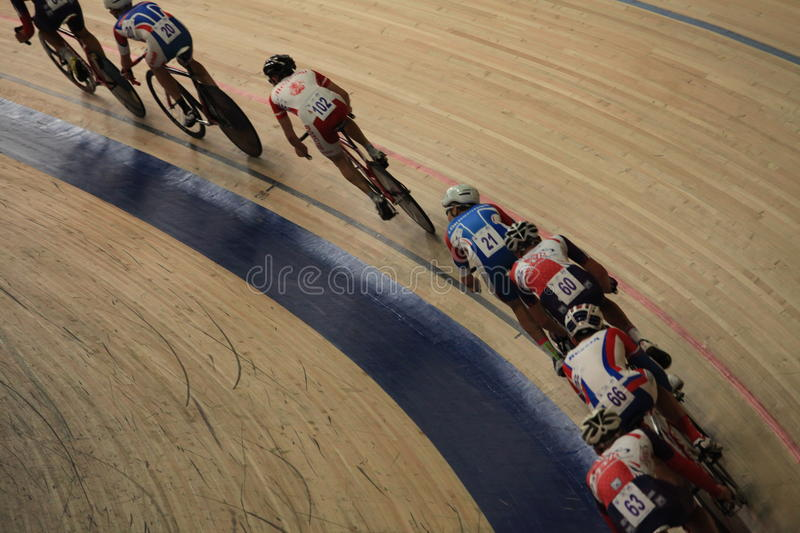Cycle race on the track motion blur. St. Petersburg, Russia,7 August 2014 Championship of Russia on cycling races on the track among juniors stock photos