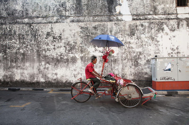 Download Cycle Rickshaw Is Riding Down The Street, Penang, Malaysia Editorial Stock Photo - Image of destination, heritage: 69131973