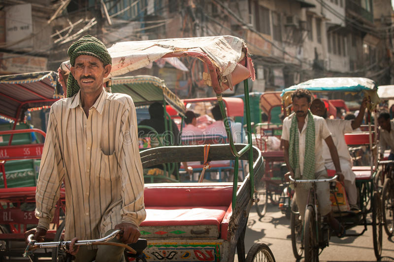 Cycle rickshaw riding the vehicle on the street of Old Delhi, India stock photos