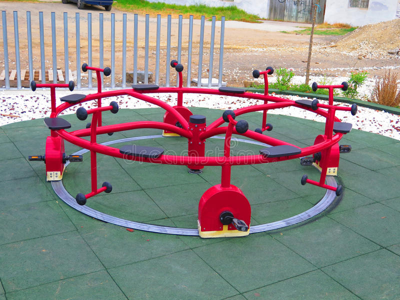 Cycle Roundabout. Childrens playground in Alora Estation, Andalucia royalty free stock photos