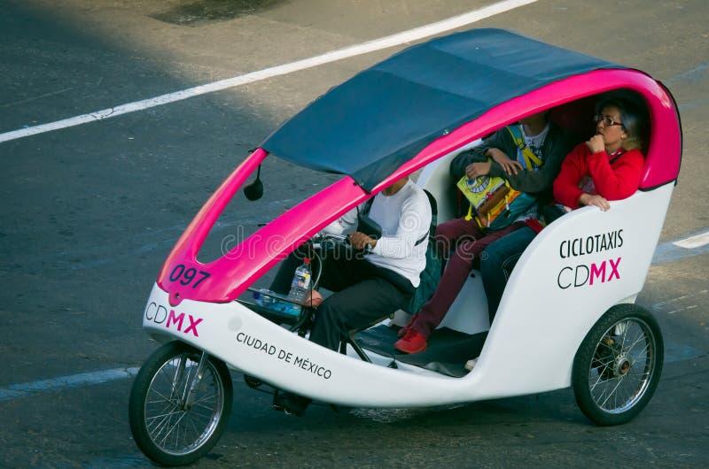 Cycle taxi at Zocalo in Mexico City. Mexico City, Mexico - December 09, 2016: Cycle taxi at Zocalo in Mexico City, Mexico royalty free stock photography