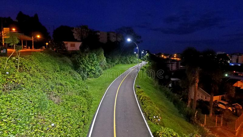 Cycle track, seen at dawn. Very busy place during the day. Ciclovia via Carlos Barbosa, Brazil. Practice place for races, walks and bike rides stock photo