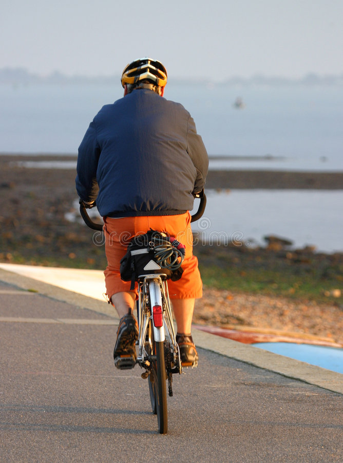 Download Cycling stock image. Image of wobble, shore, shorts, helmet - 50181