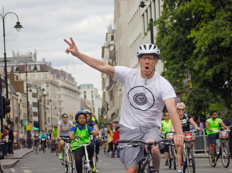 Cycling Activist Peace Victory Sign. A pro-cycling activist shows the peace/victory sign with two fingers. 04/08/2015 - RideLondon festival of cycling , London stock photography