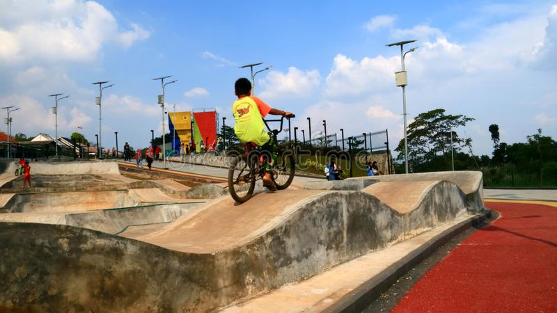 Cycling at Alun-alun Depok. Depok, Indonesia - April 14, 2019: Child play bicycle at Alun-alun Depok green open space in Grand Depok City, West Java stock images