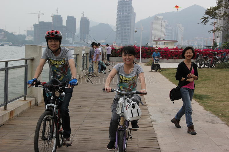 Cycling of the Asian young in shenzhen,china royalty free stock photos