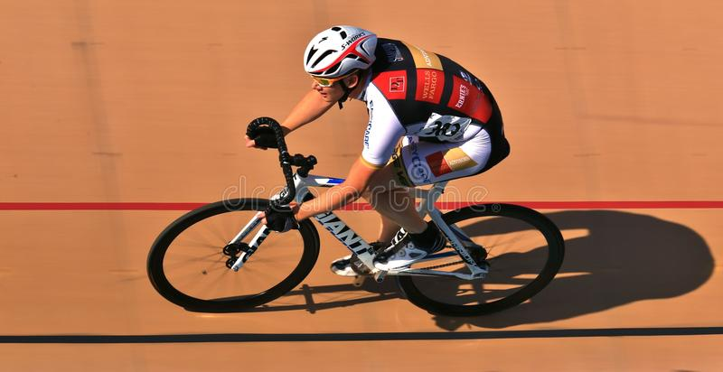 Cycling on a banked oval. Pro Bike races along the velodrome track stock photos