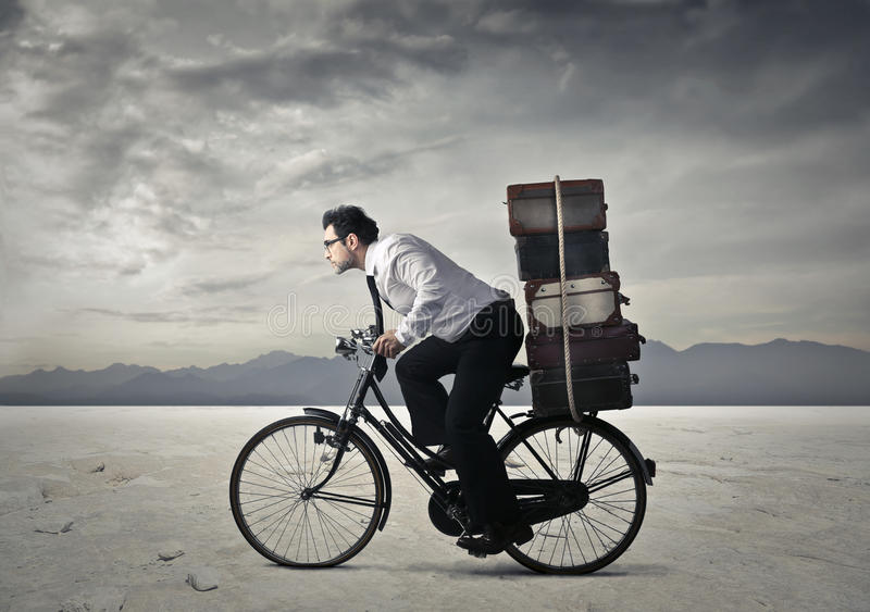 Cycling. A businessman expressing a business concept royalty free stock image