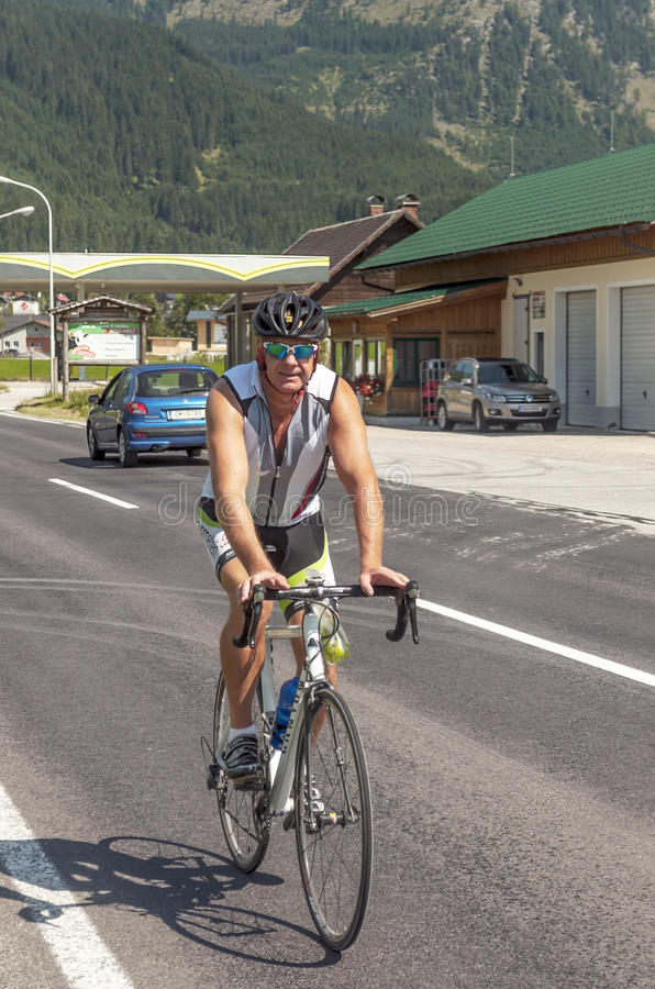 Cycling circulating in the austrian roads. Austrian cyclist circulating gossen roads on a sunny day. It is an editorial image vertically stock photography