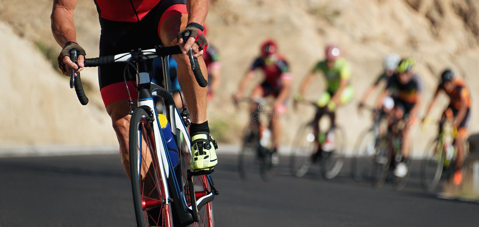 Cycling competition, cyclist athletes riding a race royalty free stock photo