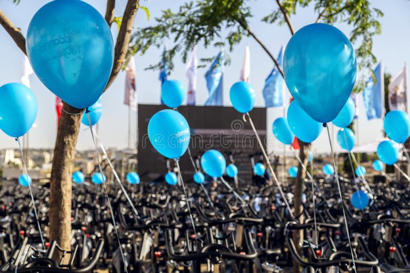 Cycling equipment and blue ballons on a public fitness event in. Jerusalem, Israel - June 14, 2018: Cycling equipment and blue ballons on a public fitness event royalty free stock images