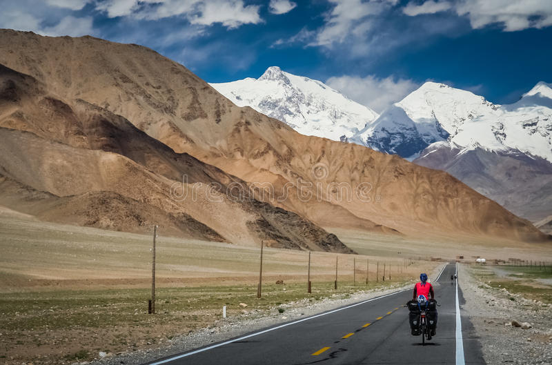 Cycling on Karakorum Highway stock photos
