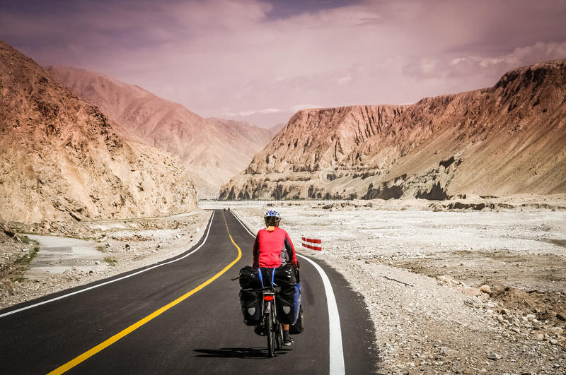 Cycling on Karakorum Highway stock photo