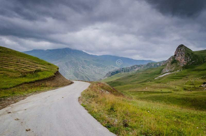 Cycling mountain road. Misty mountain road in high mountains.. Cloudy sky with mountain road stock photography