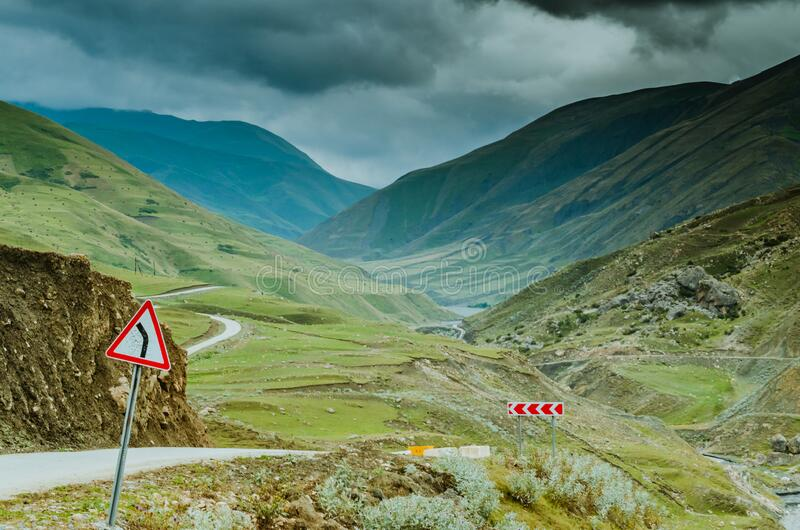 Cycling mountain road. Misty mountain road in high mountains.. Cloudy sky with mountain road royalty free stock image