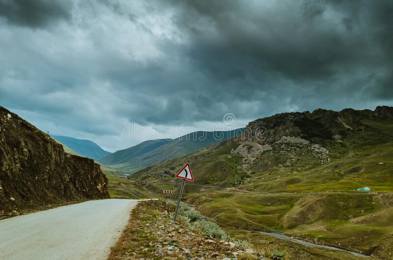 Cycling mountain road. Misty mountain road in high mountains.. Cloudy sky with mountain road stock photos