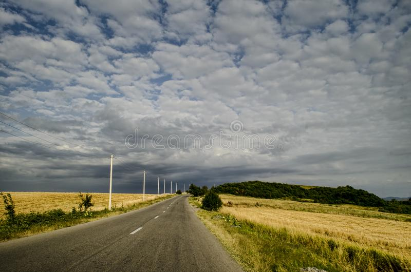 Cycling mountain road. Misty mountain road in high mountains. Cloudy sky with mountain road of Azerbaijan royalty free stock photo