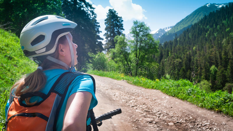 Cycling in mountains royalty free stock photography