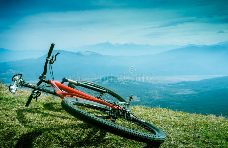 Cycling in mountains stock photos