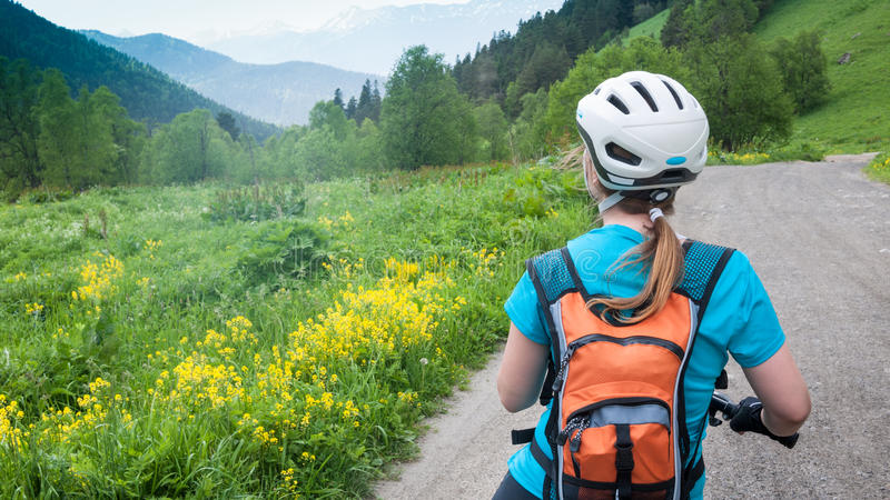 Cycling in mountains royalty free stock images