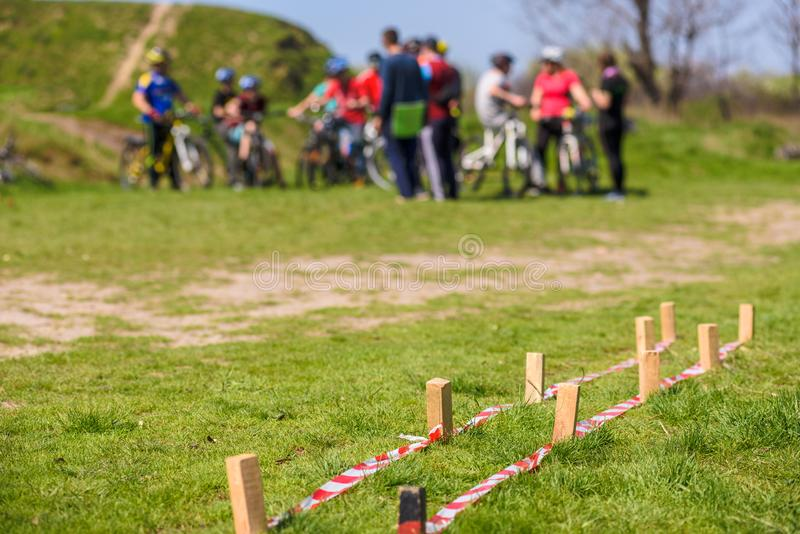 Cycling obstacle course. Group of bike riders on the background royalty free stock photos