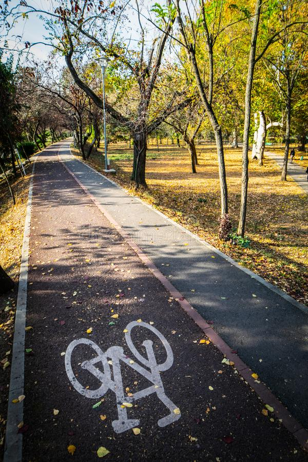 Cycling paths in Timisoara park. Cycle pathway with asign in the park of Timisoara royalty free stock photos