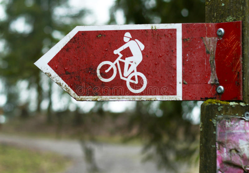 Cycling road signs. Red cycling road signs in one directions royalty free stock photos
