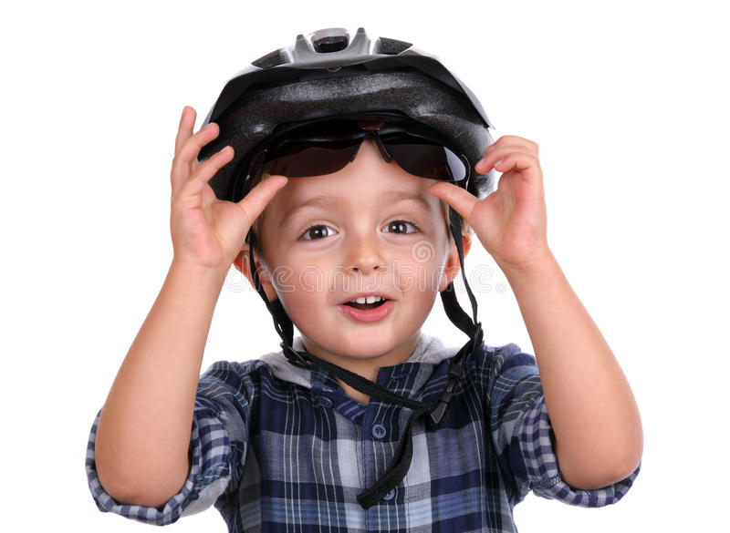 Cycling safety. Boy with cycling helmet removing sunglasses royalty free stock photo