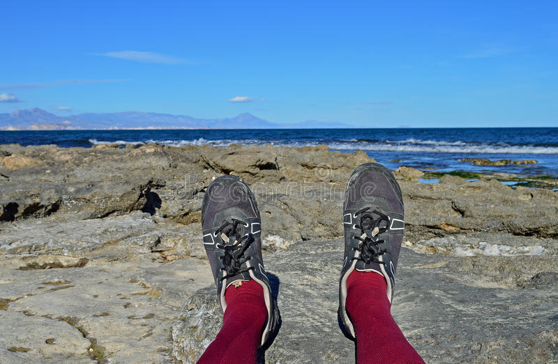 Cycling Shoes And A Rocky Shore stock photos