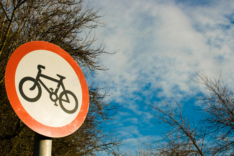 Cycling sign on blue sky stock photography