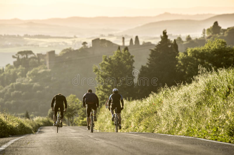 Cycling in Sunset time at tuscany stock photo