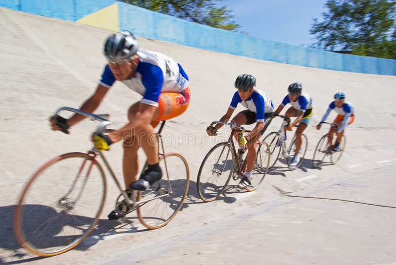 Cycling team fast racing on velodrome royalty free stock images