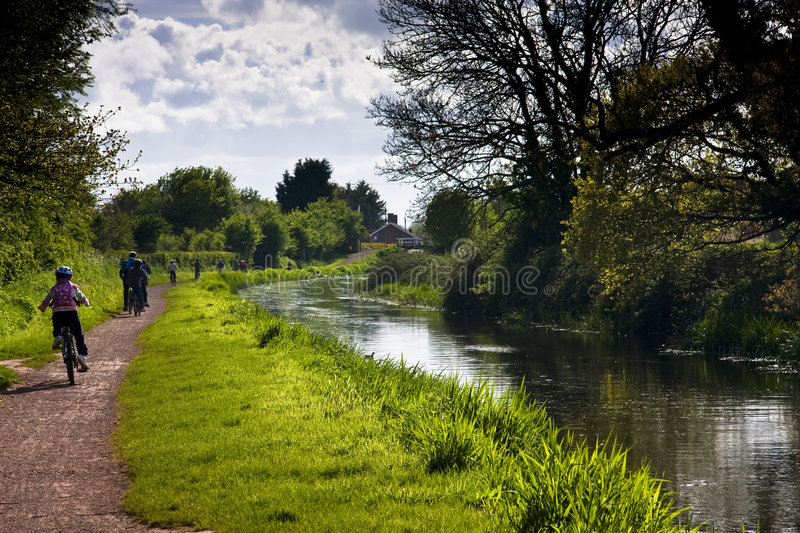 Cycling on the towpath. People on their bycycles along the bridgwater and taunton canal towpath stock photography