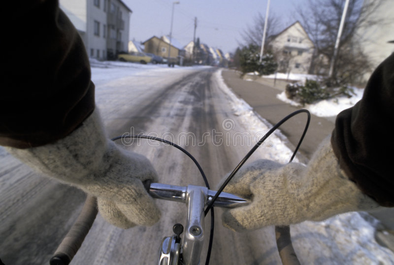 Cycling in the winter on snow stock images