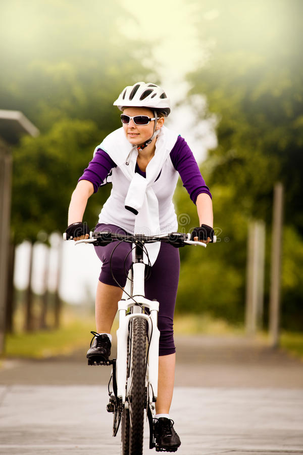 Cycling woman stock photography
