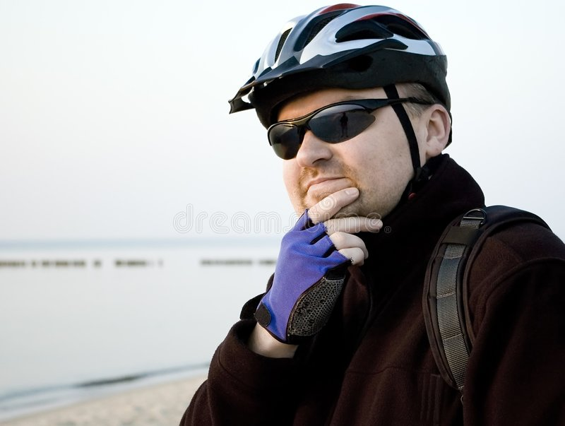 Cyclist at the beach royalty free stock images