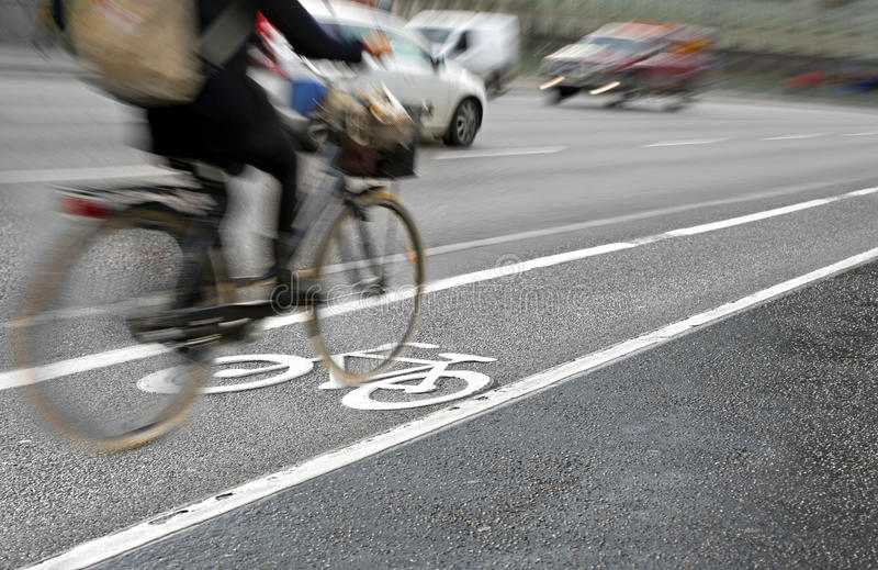 Cyclist in bicycle lane royalty free stock images