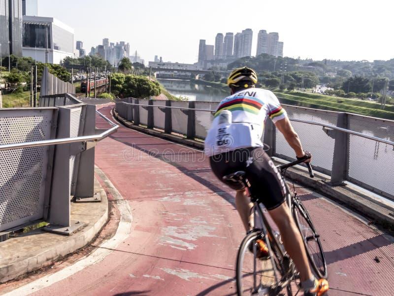 Cyclist on bicycle Lane near of Pinheiros River stock photos